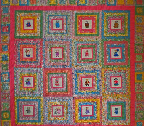 Log cabin quilt squares with a large center square