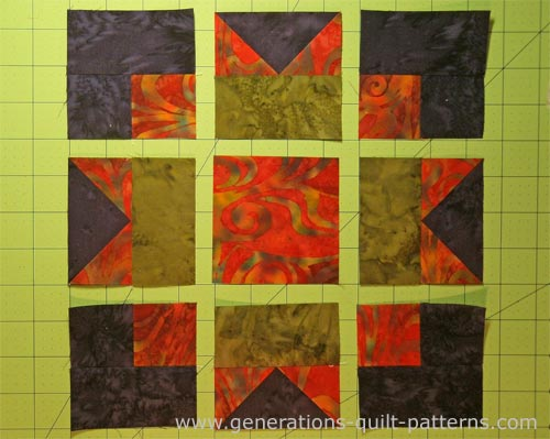 Lay out the patches for your Maple Leaf quilt block into rows