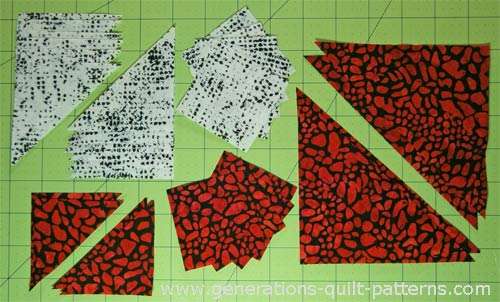 The cut patches for this version of the Monkey Wrench quilt block