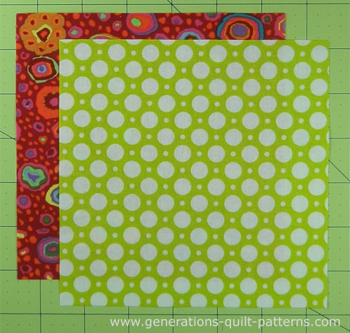 Cut patches to make two nine patch quilt blocks