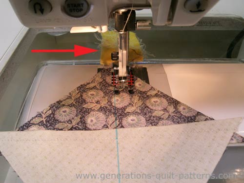Again, stitch a quarter inch away from both sides of the line