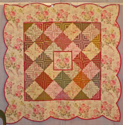 Pink Medallion Log Cabin Quilt by Jackie Olmstead