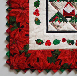Prairie points finish the edge of this quilt