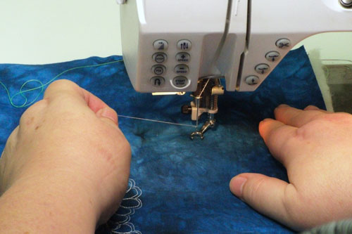 Holding onto the needle thread