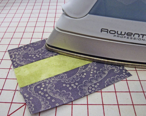 Press the seam allowance towards the darker fabric