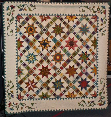 Stars of the Prairie<br />Pride of the Prairie's 2012 Raffle Quilt<br /><br />(Click on a thumbnail image below for a larger picture.)<br /><br />