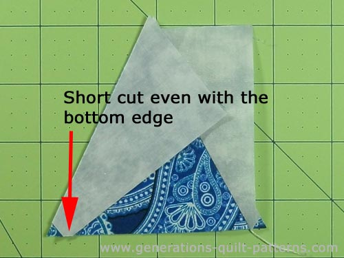 Match the edges of the second side triangle to the center triangle